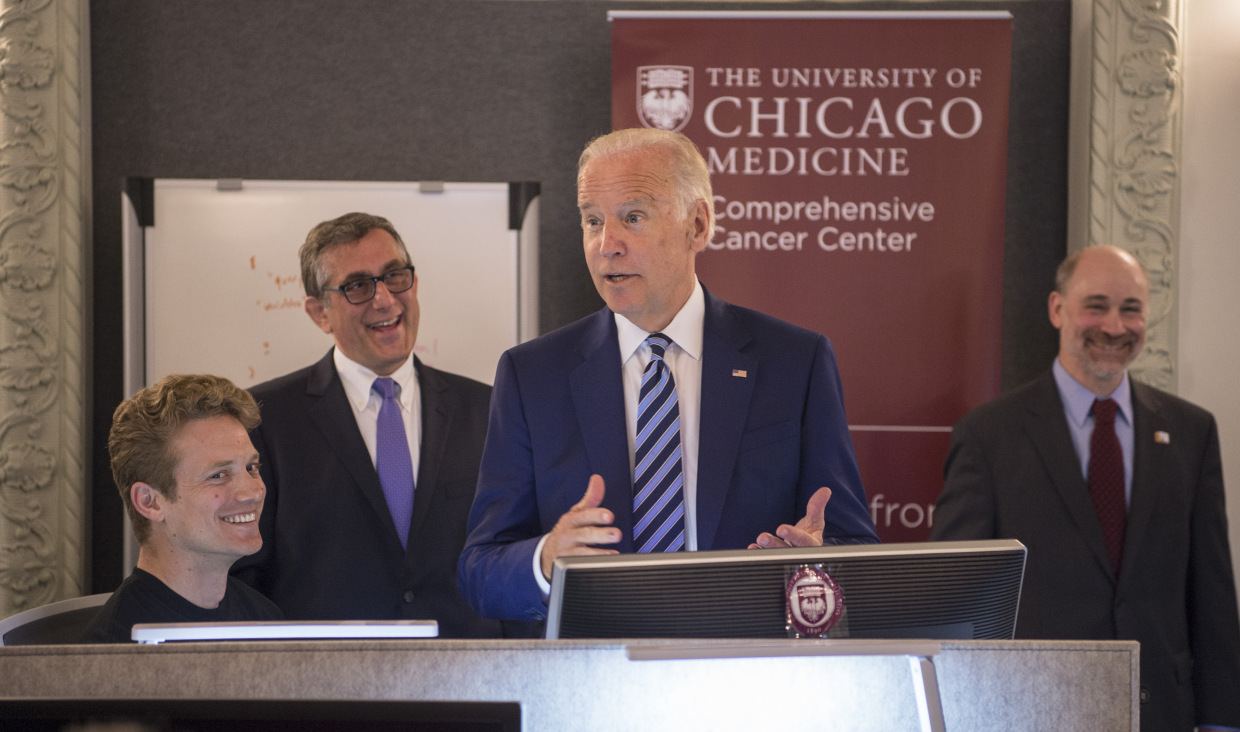 Vice President Joe Biden talks with (from left): Jeremiah Savage, MS, Ken Onel, MD, PhD, and Prof. Robert Grossman, PhD, as the vice president toured the NCI Genomic Data Commons (GDC) Monday, June 6, 2016. (Photo by Robert Kozloff; source: Genomic Data Commons at UChicago heralds new era of data sharing for cancer research)